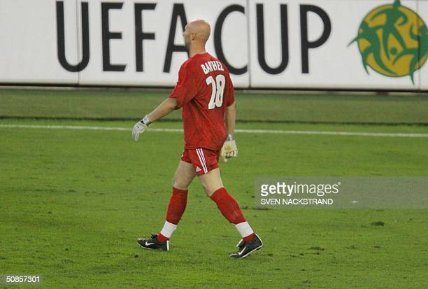 Marseille's French goalkeeper Fabien Barthez walks off the pitch after receiving a red card and giving away a penalty to Valencia during the final of...