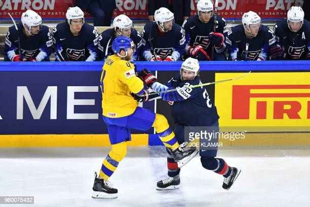 Sweden Mattias Ekholm vies with US United States' Blake Coleman during the semifinal match Sweden vs USA of the 2018 IIHF Ice Hockey World...