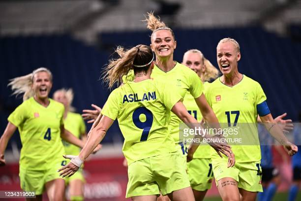 Sweden midfielder Asllani Kosovare celebrates with teammates after scoring a penalty during the Tokyo 2020 Olympic Games women's quarter-final...