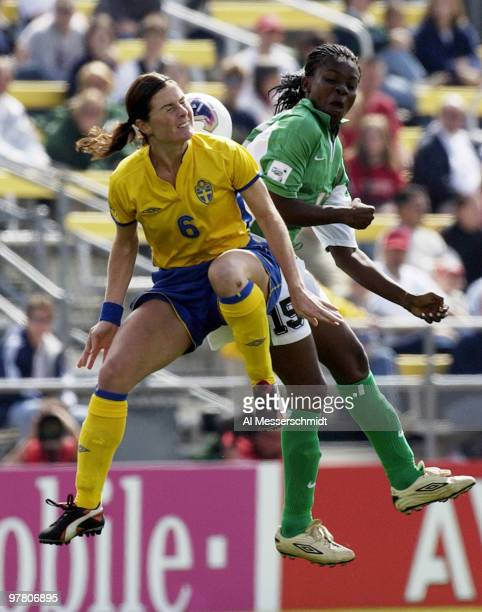 Sweden midfielder Malin Mostroem leaps for a header Sunday September 28 2003 at Columbus Crew Stadium Columbus Ohio during the opening round of the...