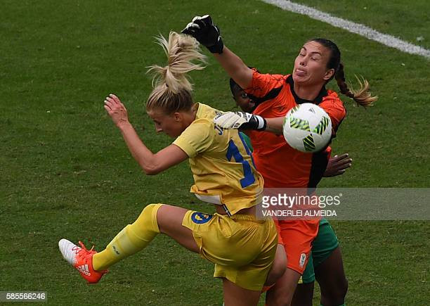 Sweden player Sofia Jakobsson vie for the ball with South Africa goalkeeper Roxanne Barker during the Rio 2016 Olympic Games womens First Round Group...