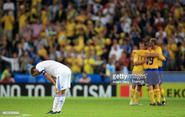 Sweden players celebrate as Greece's Angelos Basinas stands dejected