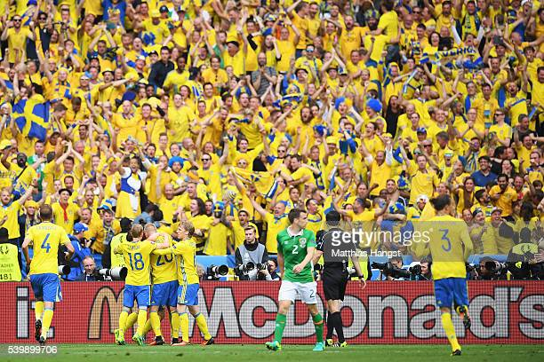 Sweden players celebrate their team's first goal in front of their supporters during the UEFA EURO 2016 Group E match between Republic of Ireland and...
