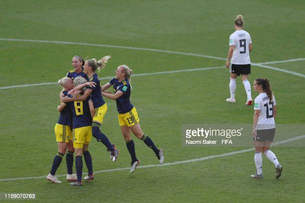 Sweden players celebrate victory at fulltime after the 2019 FIFA Women's World Cup France Quarter Final match between Germany and Sweden at Roazhon...