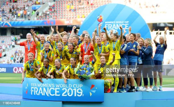 Sweden players celebrate with their 3rd place medals following their sides victory in the 2019 FIFA Women's World Cup France 3rd Place Match match...