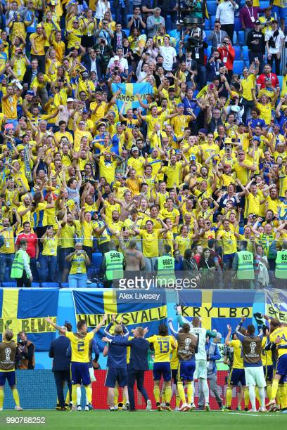 Sweden players celebrate with thier fans following their sides victory in the 2018 FIFA World Cup Russia Round of 16 match between Sweden and...