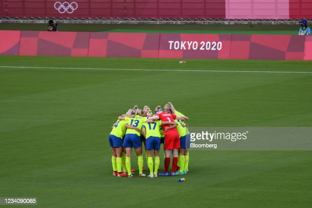 Sweden players huddle ahead of an opening round women's football match between the U.S. And Sweden at the Tokyo 2020 Olympic Games in Tokyo, Japan,...