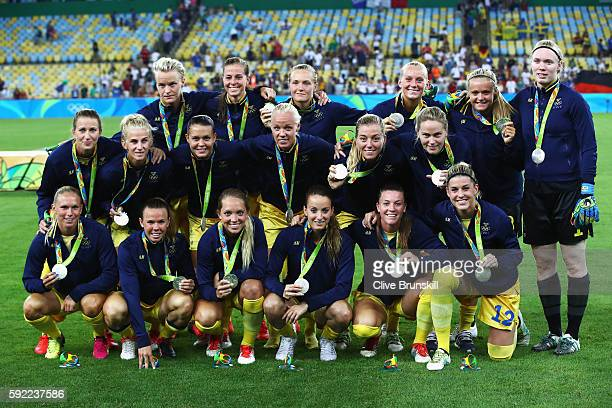 Sweden pose with their silver medals following defeat during the Women's Olympic Gold Medal match between Sweden and Germany at Maracana Stadium on...