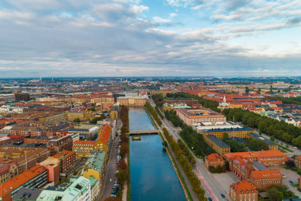Sweden, Scania, Malmo, Aerial view of Sodra Forstadskanalen river canal at dusk