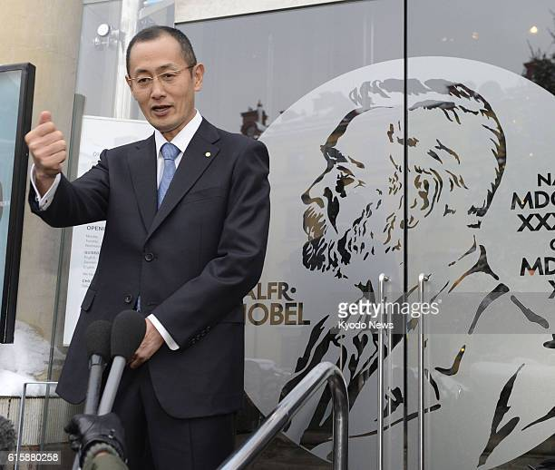 STOCKHOLM Sweden Shinya Yamanaka a professor of Kyoto University answers reporters' questions in front of the Nobel Museum in Stockholm Sweden after...