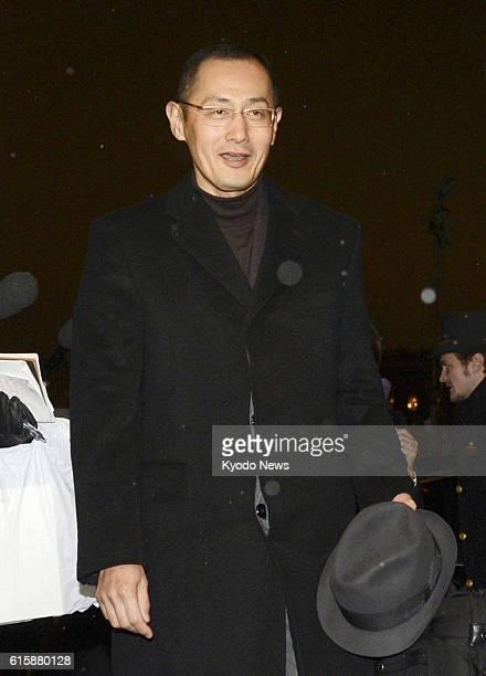 STOCKHOLM Sweden Shinya Yamanaka a professor of Kyoto University enters a hotel after arriving in Stockholm Sweden on Dec 4 2012 Yamanaka plans to...