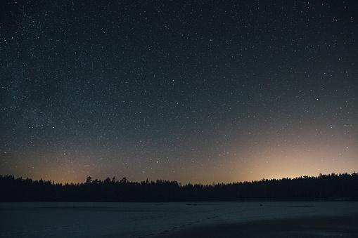 Sweden, Sodermanland, frozen lake Navsjon in winter under starry sky at night - gettyimageskorea
