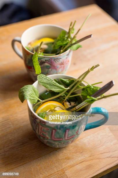 Sweden, Stockholm, Gamla Stan, Two cups with leaves and lemon slices