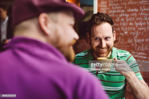 Sweden, Stockholm, Gamla Stan, Two men having coffee in cafe