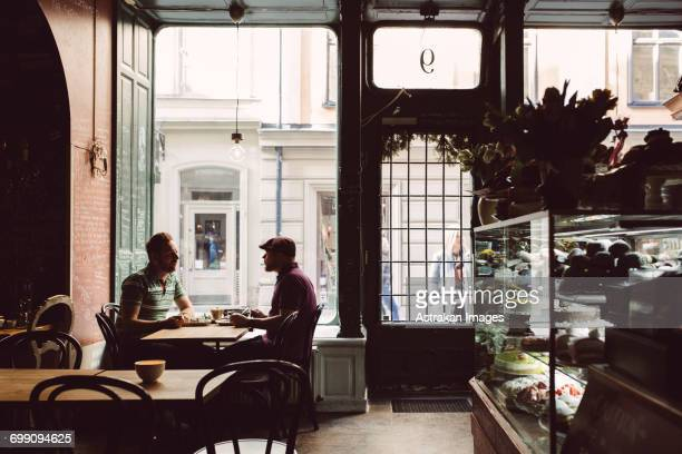 Sweden, Stockholm, Gamla Stan, Two men having coffee in cafe