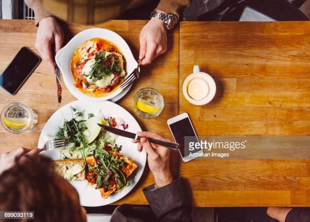 Sweden, Stockholm, Gamla Stan, Two men having lunch