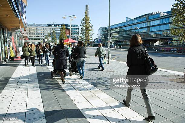 sweden, stockholm, pedestrians walking on wide sidewalk - 歩行者 ストックフォトと画像