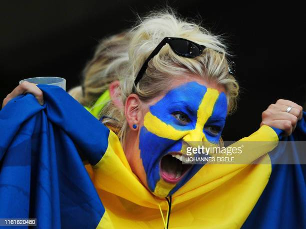 Sweden supporter cheers prior to the Group C match of the FIFA women's football World Cup Sweden vs USA on July 6, 2011 in Wolfsburg, northern...