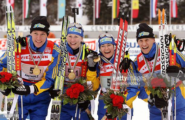 Sweden team Bjorn Ferry Helena Jonsson Anna Carin Olofsson and Carl Johan Bergman pose with their gold medals as they won the mixed 2 x 6 2 x 75 km...