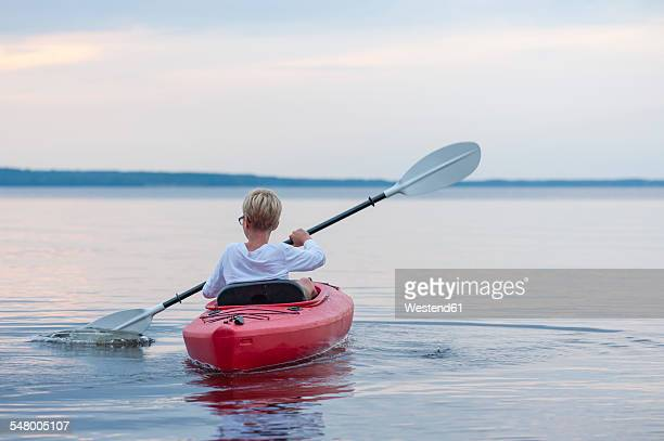 Sweden, Vastra Gotaland County, Lake Skagern, kayaking boy