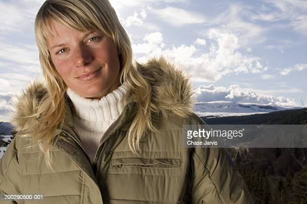 sweden, young woman smiling, mountains in background, portrait - fur trim stock pictures, royalty-free photos & images