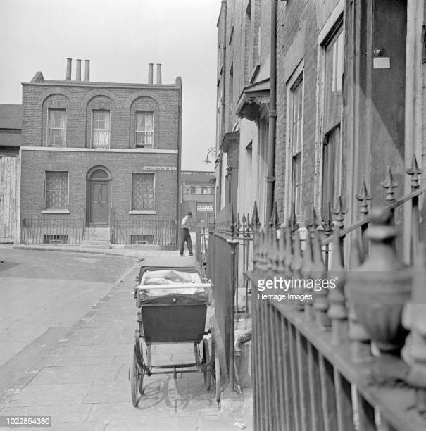 Swedenborg Square Stepney London circa 1945circa 1960 A pram stands on the pavement outside a house in the square A detached house stands on the...