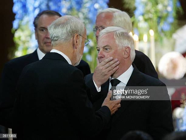 Sweden's acting Foreign Minister Jan O Karlsson and European Union's External Relations Commissioner Chris Patten of Britain share a moment during...