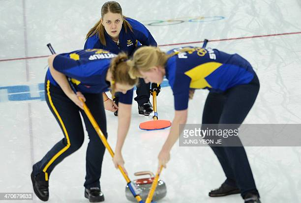 Sweden's Agnes Knochenhauer watches the stone during the Women's Curling Gold Medal Game Sweden vs Canada at the Ice Cube Curling Center during the...