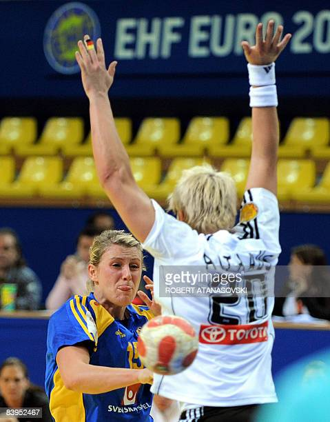 Sweden's Ahlm Johanna shoots past Germany's Althaus Anja and goalkeeper Woltering Clara during the 8th Women's Handball European Championships match...