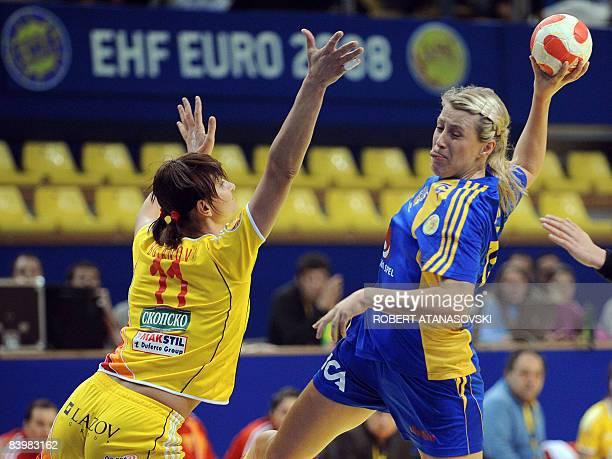 Sweden's Ahlm Johanna shoots past Macedonia's Bujanova Olga during the 8th Women's Handball European Championships match on December 10 2008 in Boris...