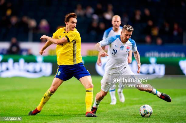 Sweden's Albin Ekdal fights for the ball with Juraj Kucka during the friendly football match between Sweden and Slovakia in Stockholm Sweden on...