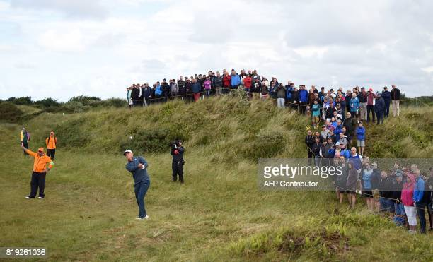 TOPSHOT Sweden's Alex Noren plays from the rough on the 9th hole during his opening round on the first day of the Open Golf Championship at Royal...