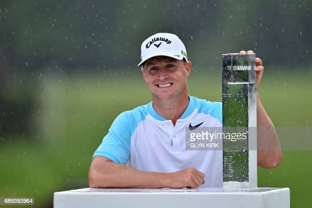 Sweden's Alex Noren poses with the trophy after winning the PGA Championship at Wentworth Golf Club in the town of Virginia Water in Surrey southwest...