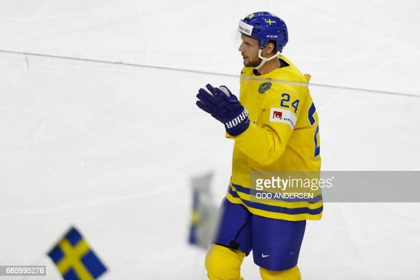 Sweden's Alexander Edler celebrates scoring the opening goal during the IIHF Men's World Championship Ice Hockey semi-final match between Sweden and...