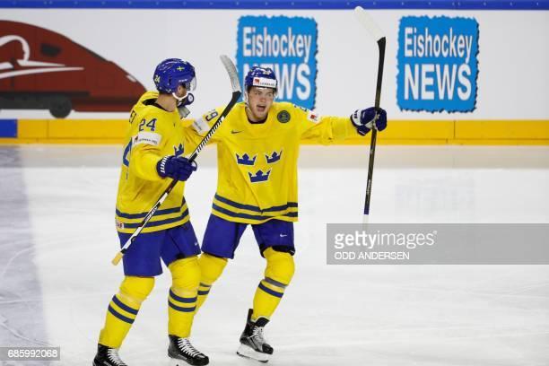 Sweden's Alexander Edler celebrates scoring the opening goal with his teammate William Nylander during the IIHF Men's World Championship Ice Hockey...