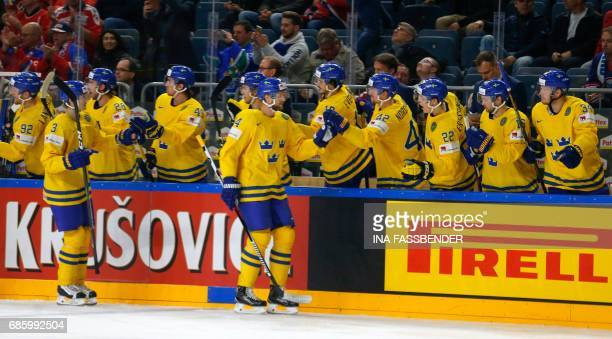 Sweden's Alexander Edler celebrates scoring the opening goal with his teammates during the IIHF Men's World Championship Ice Hockey semi-final match...