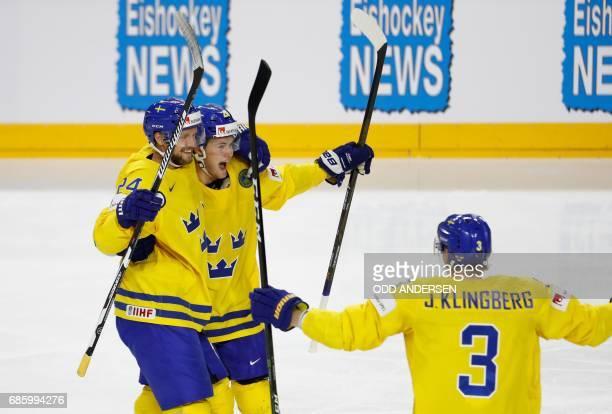 Sweden's Alexander Edler celebrates scoring the opening goal with his teammates William Nylander and John Klingberg during the IIHF Men's World...