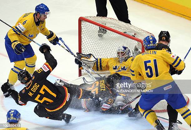 Sweden's and Germany's players vie during the IIHF Ice Hockey World Championship match for the Bronze medal Sweden vs Germany in the western German...