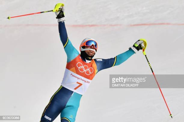 TOPSHOT Sweden's Andre Myhrer celebrates winning gold following the Men's Slalom at the Yongpyong Alpine Centre during the Pyeongchang 2018 Winter...