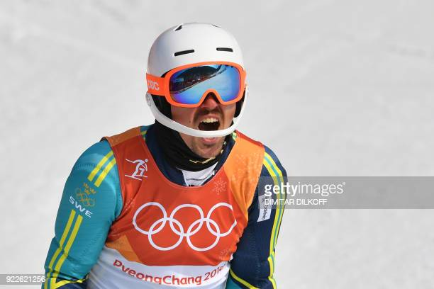 TOPSHOT Sweden's Andre Myhrer reacts as he celebrates winning gold following the Men's Slalom at the Yongpyong Alpine Centre during the Pyeongchang...
