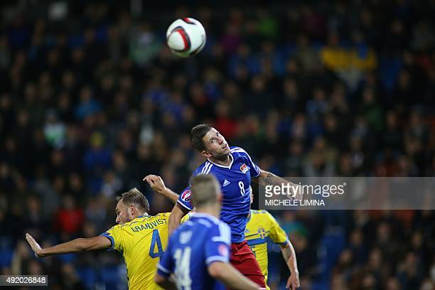 Swedens Andreas Granqvist vies with Liechtensteins Sandro Wieser during the Euro 2016 Group G qualifying football match between Liechtenstein and...