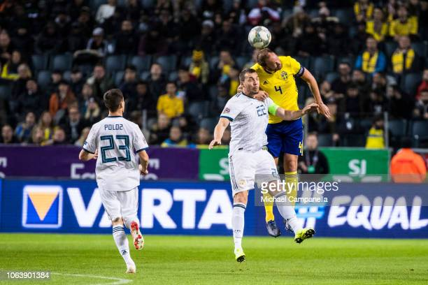 Sweden's Andreas Granqvist wins an arial duel against Russia's Artem Dzyuba during the UEFA Nations League B group two match between Sweden and...