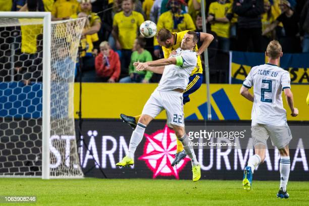 Sweden's Andreas Granqvist wins an arial duel againt Russia's Artem Dzyuba during the UEFA Nations League B group two match between Sweden and Russia...