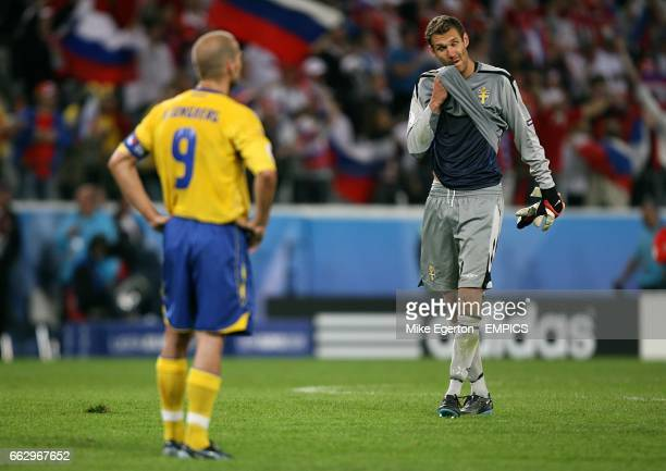 Sweden's Andreas Isaksson and Fredrik Ljungberg look dejected after the final whistle