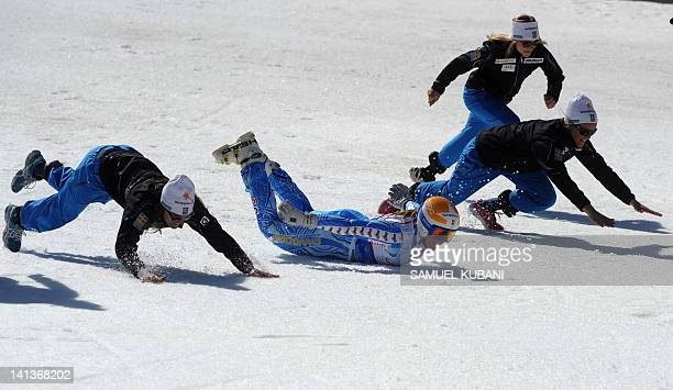 Sweden's Anja Paerson and her teammates imitate penguin's slide in finish area of the women's superG final race of the season at the Alpine skiing...
