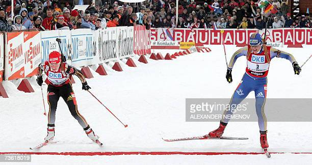 Sweden's Anna Carin Olofsson crosses the finish line ahead of Germany's Andrea Henkel to place second in the IBU World Cup biathlon final Women's 10...