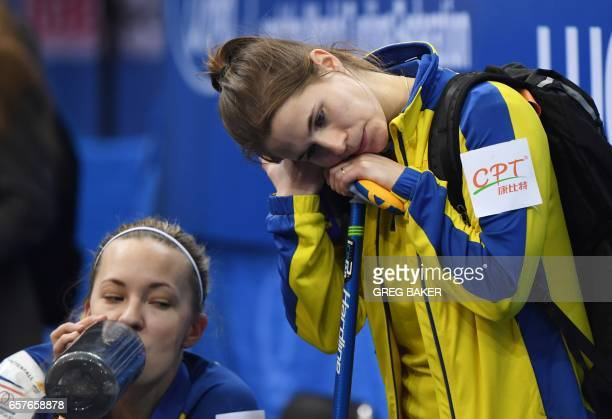 Sweden's Anna Hasselborg and Agnes Knochenhauer reacts after losing to Russia in the semifinal of the Women's Curling World Championships in Beijing...