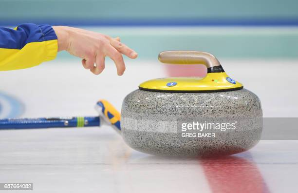 Sweden's Anna Hasselborg releases the stone during the semifinal Russia vs Sweden at the Women's Curling World Championships in Beijing on March 25...