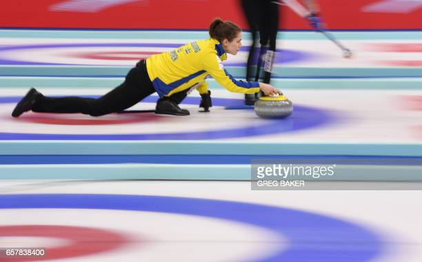 Sweden's Anna Hasselborg releases the stone during their bronze medal match against Scotland at the Women's Curling World Championships in Beijing on...