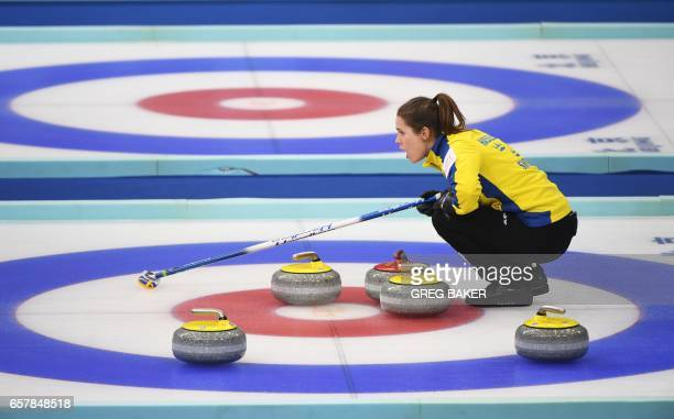 Sweden's Anna Hasselborg waits behind stones during the bronze medal match against Scotland at the Women's Curling World Championships in Beijing on...
